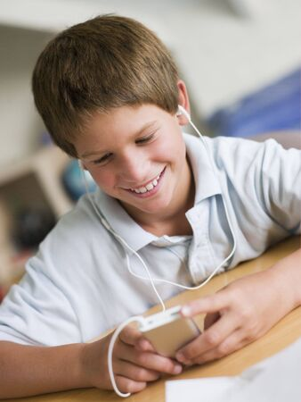 preteen boy: Young Boy  Playing With An MP3 Player