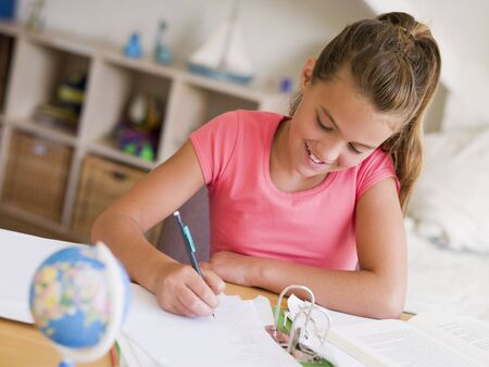preadolescent: Young Girl Doing Her Homework