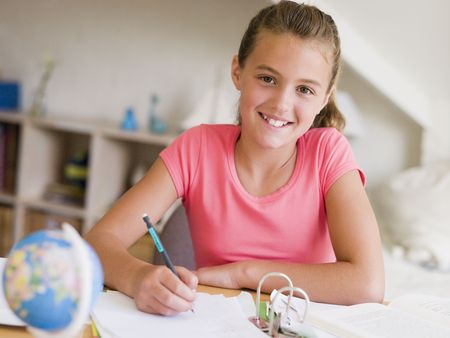 assignments: Young Girl Doing Her Homework