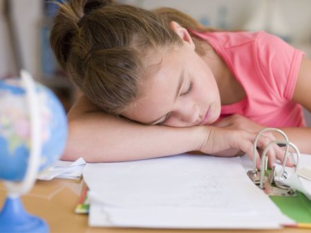Young Girl Asleep On Her Homework photo