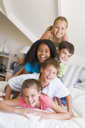 9 year old girl: Five Young Friends Lying On Top Of Each Other