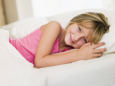 Young Girl Lying In Her Bed photo