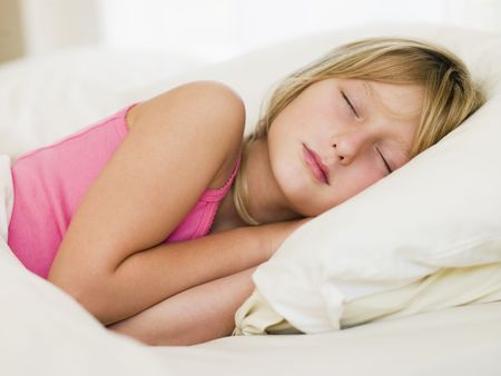 girl lying down: Young Girl Lying In Her Bed Stock Photo