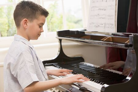 casual clothing 12 year old: Boy Playing Piano