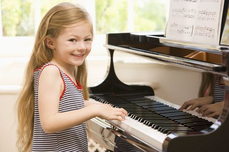 Young Girl Playing Piano photo