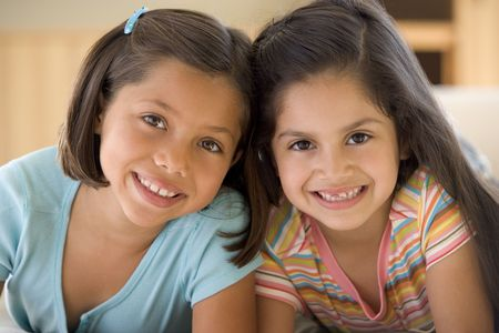 american children: Portrait Of Two Young Girls Stock Photo