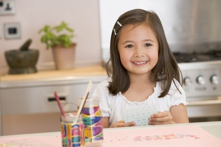 age 5: Young Girl Drawing Pictures