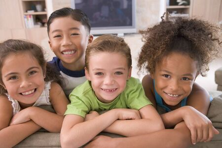 6 year old children: Four Young Friends Hanging Out At Home Stock Photo
