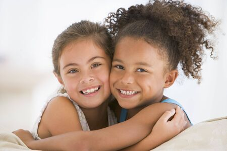 two girls hugging: Best Friends Hugging Stock Photo