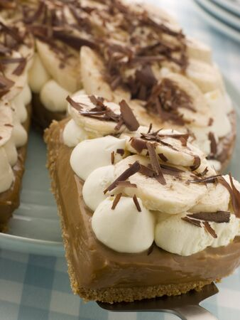 chocolate tart: Banoffee Pie With A Slice Being Taken