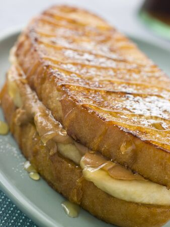 banana bread: Peanut Butter And Banana Eggy Bread Sandwich With Syrup Stock Photo
