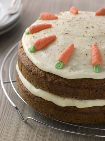 carrot cake: American Carrot Cake On A Cooling Rack Stock Photo