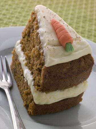 Slice Of American Carrot Cake On A Plate With A Fork photo