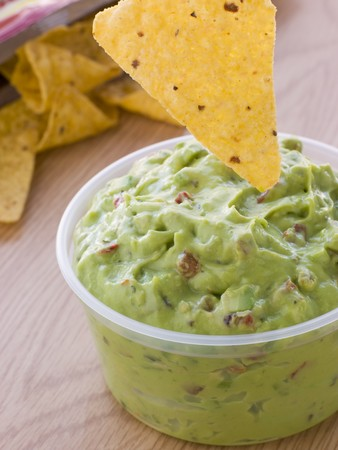 Pot Of Guacamole With A Corn Tortilla Crisp Stock Photo - 4422447