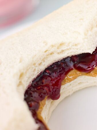 Peanut Butter And Raspberry Jelly Sandwich On White Bread photo