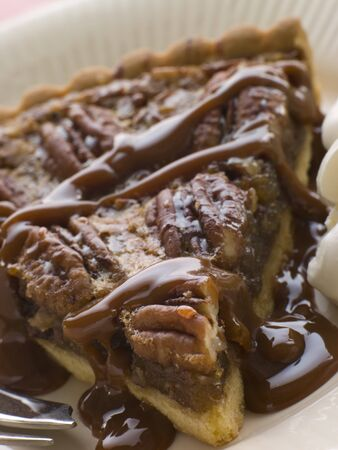 pecan: Slice Of Pecan Pie With Caramel Sauce And A Fork
