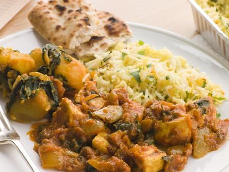 Chicken Bhoona, Sag Aloo, Pilau Rice And Naan Bread photo