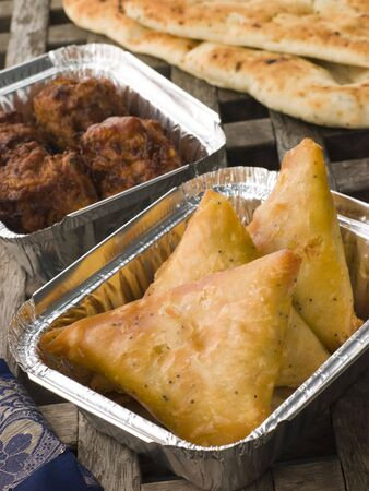 Indian Take Away- Vegetable Samosa, Naan Bread And Onion Bahji Stock Photo - 4444426
