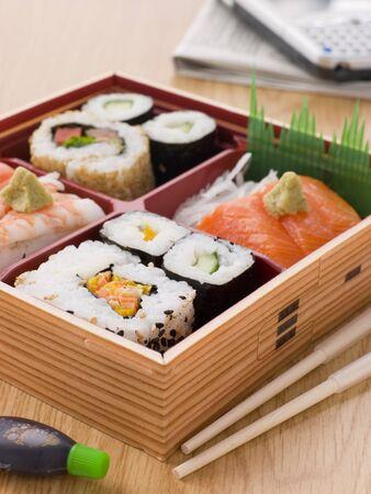 bento box: Sushi And Sashimi In A Take Away Bento Box