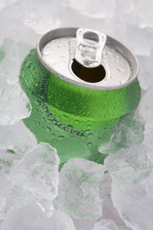 Green Can Of Fizzy Soft Drink Set In Ice With The Ring Pulled photo