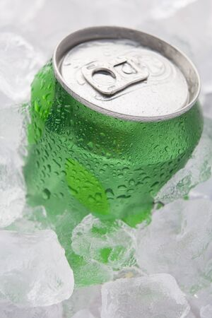 green drink: Green Can Of Fizzy Soft Drink Set In Ice
