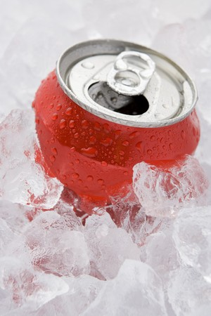 Red Can Of Fizzy Soft Drink Set In Ice With The Ring Pulled  photo
