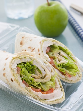 Chicken Salad Tortilla Wrap With A Green Apple And Water photo