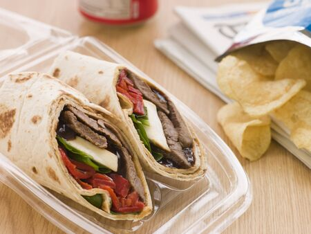 Steak, Cheese, Red Pepper And Barbeque Sauce Tortilla Wrap With A Can Of Cola And Packet Of Crisps Stock Photo - 4445763