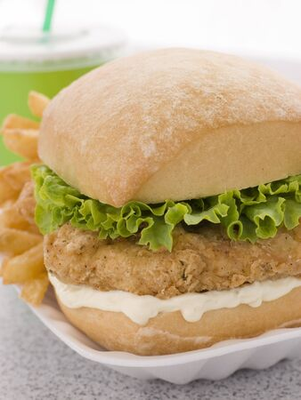 Southern Fried Chicken Fillet Burger With Fries And A Soft Drink photo