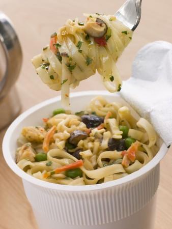 instant noodles: Pot Of Instant Chicken Noodles Stock Photo