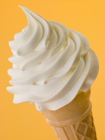 Soft Whipped Ice Cream In A Wafer Cone Stock Photo - 4444591