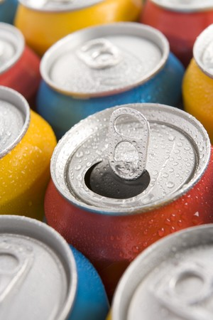 carbonated drink: Close Up Of Multi Colored Soda Cans With One Open Stock Photo