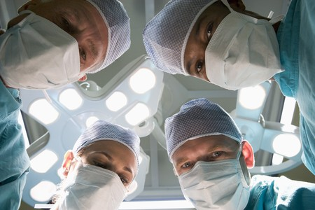 operating room: Low Angle View Of Four Surgeons