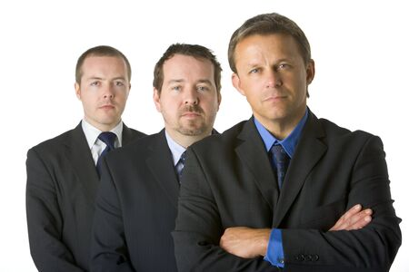 Group Of Businessmen Looking Stern   photo