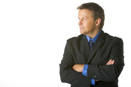 looking sideways: Businessman Looking Sideways Stock Photo