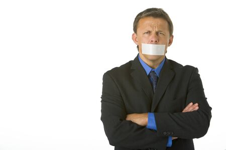 Businessman With His Arms Folded  And His Mouth Taped Shut  photo
