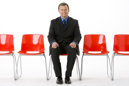 fourties: Businessman Sitting In Row Of Empty Chairs