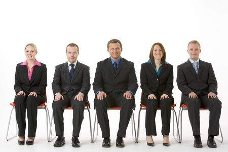 conformity: Group Of Business People Sitting In A Line  Stock Photo