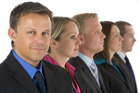 Group Of Business People In A Line Looking photo