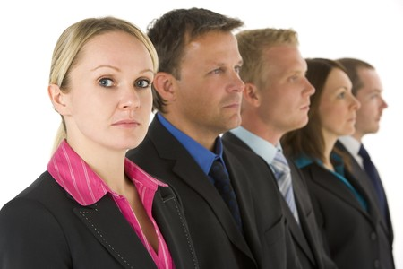 Group Of Business People In A Line Looking Serious photo