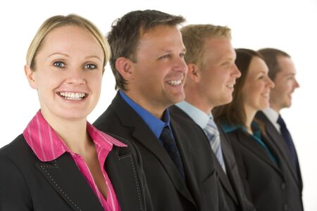 Group Of Business People In A Line Smiling photo