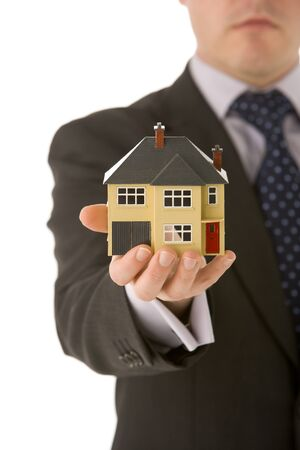 Businessman Holding Small House  photo