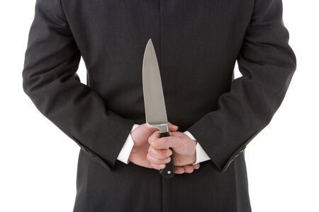 Businessman Holding Knife Behind His Back Stock Photo - 4445967
