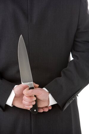 Businessman Holding Knife Behind His Back photo