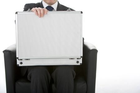 Businessman Sitting Opening Brief Case Stock Photo - 4444950