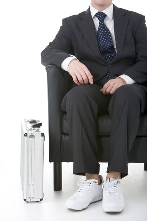 Businessman Sitting Wearing Sneakers photo