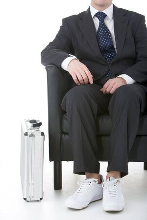 Businessman Sitting Wearing Sneakers Stock Photo - 4444662