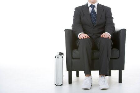 Businessman Sitting Wearing Sneakers Stock Photo - 4444448