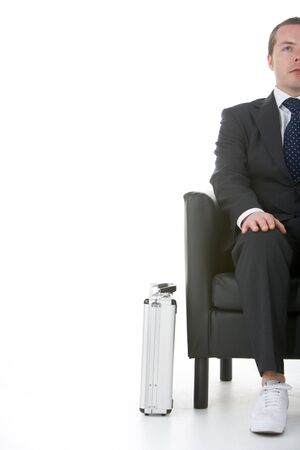 Businessman Sitting Wearing Sneakers Stock Photo - 4444429