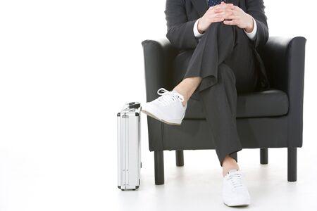 Businessman Sitting Wearing Sneakers Stock Photo - 4444454